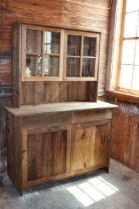 Tombstone cabinet with attached upper and wavy glass doors