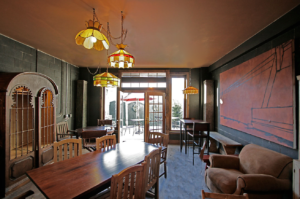 Row House Cafe Interior with salvaged doors windows lighting