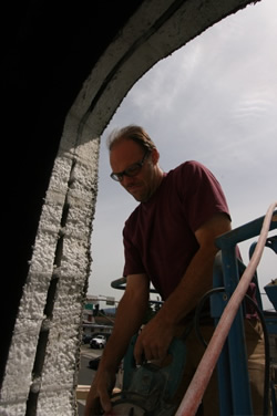 Bob Penny helps The RE Store install windows in it's Bellingham facility