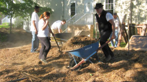 Whatcom Community College students mulching the RE Patch community garden and forest garden demonstration site