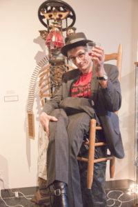 Eberhard wears a chair at te gallery opening