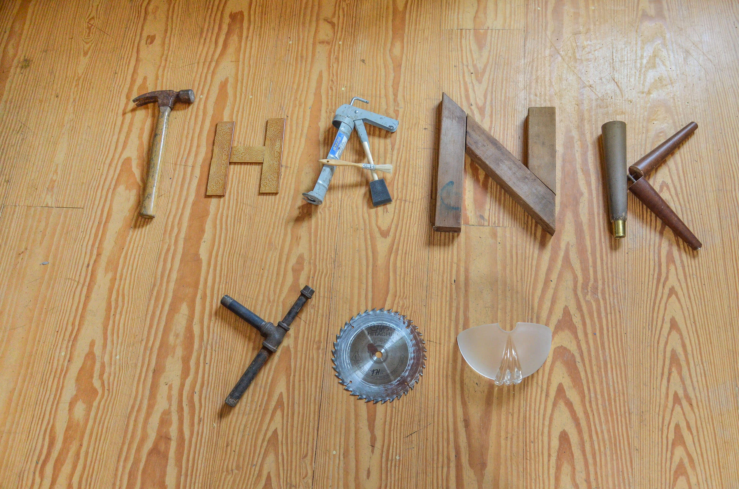 Reused materials arranged to spell thank you